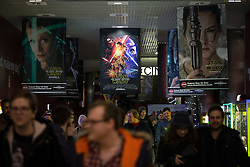 © Licensed to London News Pictures . 17/12/2015 . Manchester , UK . Crowd leaving the cinema after the midnight screening . Star Wars fans attend the midnight screening of Star Wars the Force Awakens at the AMC Great Northern cinema in Manchester City Centre . Photo credit : Joel Goodman/LNP