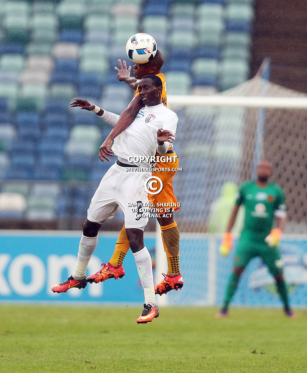 Tsepo Masilela of Kaizer Chiefs out jumps Nyiko Mobbie of Free State Stars during the Telkom Knockout quarterfinal  match between Kaizer Chiefs and Free State Stars at the Moses Mabhida Stadium , Durban, South Africa.6 November 2016 - (Photo by Steve Haag Kaizer Chiefs)