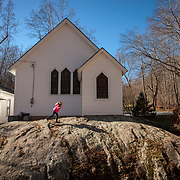 St. Paul's Episcopal Church rests on a large piece of granite above the Falling Rock Creek, on Bear Mountain, in Amherst, VA.  The church, established in 1908, rapidly became the spiritual center of Monacan Nation, particularly after a schoolhouse was built for the children.  In 1963, Amherst County allowed Monacan children to attend public schools.