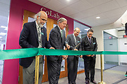 (Left to right) Chaden Djalali, executive vice president and provost; Duane Nellis, Ohio University president; David Pidwell, national trustee; and Dave Scholl, Board of Trustees chair; particpate in the ribbon cutting at the grand opening for the new CoLab, October 18, 2018. (Photo by Stephen Zenner/Ohio University Libraries)