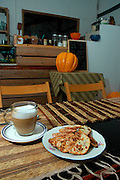 Interior of a small Cafe restaurant coffee and cake on the table