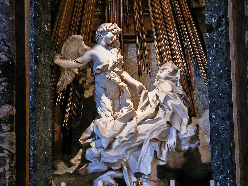 Sta Maria della Vitoria, Bernini's sculpture of Sta Teresa in ecstasy.  Famous statue taken from an angle that emphases the angel's cruelty in his readiness to stab her with his upraised arrow.