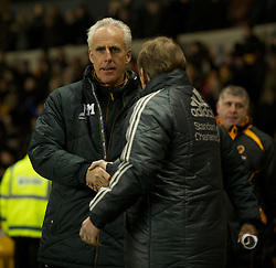 WOLVERHAMPTON, ENGLAND - Tuesday, January 31, 2012: Wolverhampton Wanderers' manager Mick McCarthy and Liverpool's manager Kenny Dalglish during the Premiership match at Molineux. (Pic by David Rawcliffe/Propaganda)