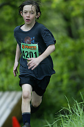 "(Kingston, Ontario---16/05/09) ""Nikolas Latchman running in the kids race at the 2009 Salomon 5 Peaks Trail Running series Race held in Kingston, Ontario as part of the Eastern Ontario/Quebec division. ""  Copyright photograph Sean Burges / Mundo Sport Images, 2009. www.mundosportimages.com / www.msievents.com."