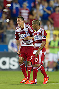 FRISCO, TX - AUGUST 11:  Blas Perez #7 of FC Dallas celebrates after scoring a goal with teammate David Ferreira #10 against the Los Angeles Galaxy on August 11, 2013 at FC Dallas Stadium in Frisco, Texas.  (Photo by Cooper Neill/Getty Images) *** Local Caption *** Blas Perez; David Ferreira
