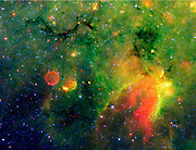 Spitzer Space Telescope infrared image of a 'snake' (upper left) and surrounding stormy environment. It is actually the core of a thick, sooty cloud large enough to swallow dozens of solar systems. Credit NASA.