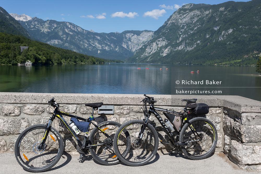 Bikes on the bridge at Ribcev Laz and out into Lake Bohinj, on 19th June, in Lake Bohinj, Sovenia