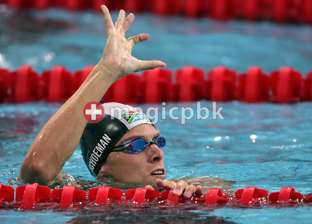 Roland Mark Schoeman of South Africa waves after finishing his men's 50m Freestyle semifinal  held at the National Aquatics Center at the Athens 2004 Summer Olympic Games in Athens, Greece, Saturday, April 18, 2009. (Photo by Patrick B. Kraemer / MAGICPBK)
