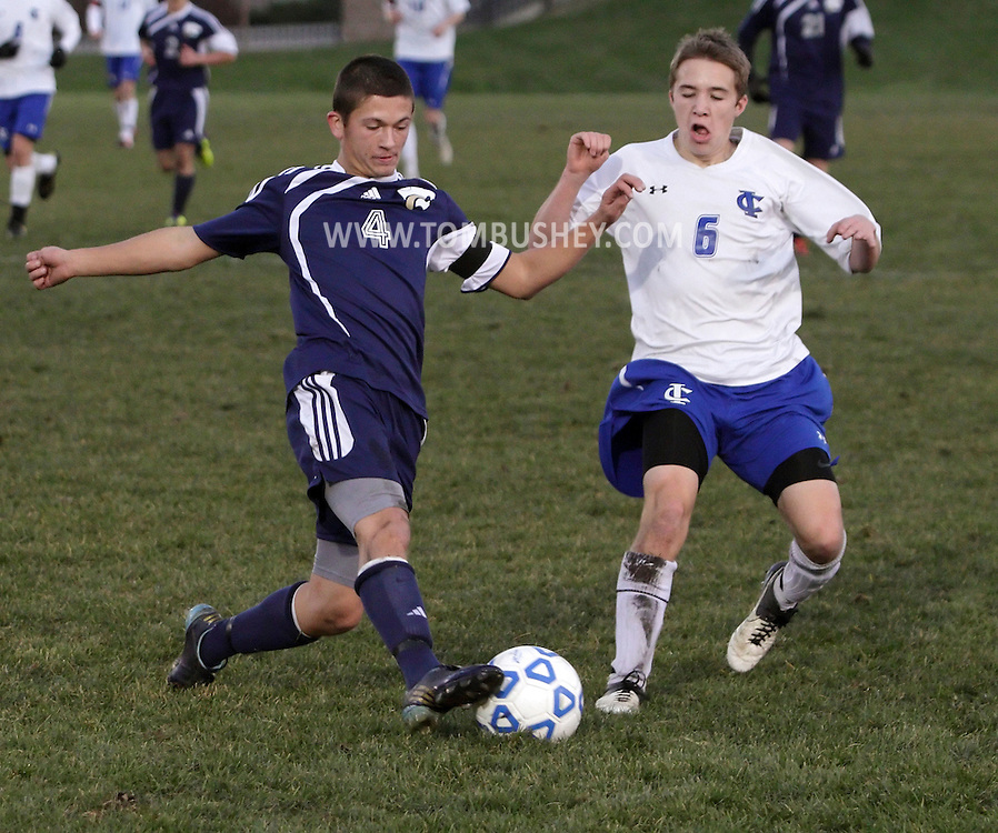 Susquehanna Valley's Liam Axton (4) kicks the ball away from Alex Niemann of Ichabod Crane during a Class B state semifinal game at Faller Field in Middletown on Saturday, Nov. 17, 2012.