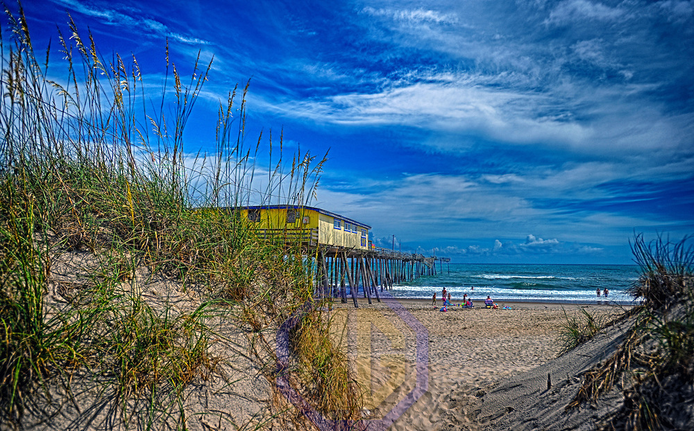 A 14 frame HDR image of the Frisco Pier that is for sale and is falling into the Atlantic Ocean.
