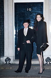 © London News Pictures. 15/02/2013.  London, UK.  British milliner Stephen Jones and fashion designer L'Wren Scott arriving at 10 Downing Street for a London Fashion Week launch party hosted by Samantha Cameron on February 15, 2013. Photo credit : Ben Cawthra/LNP