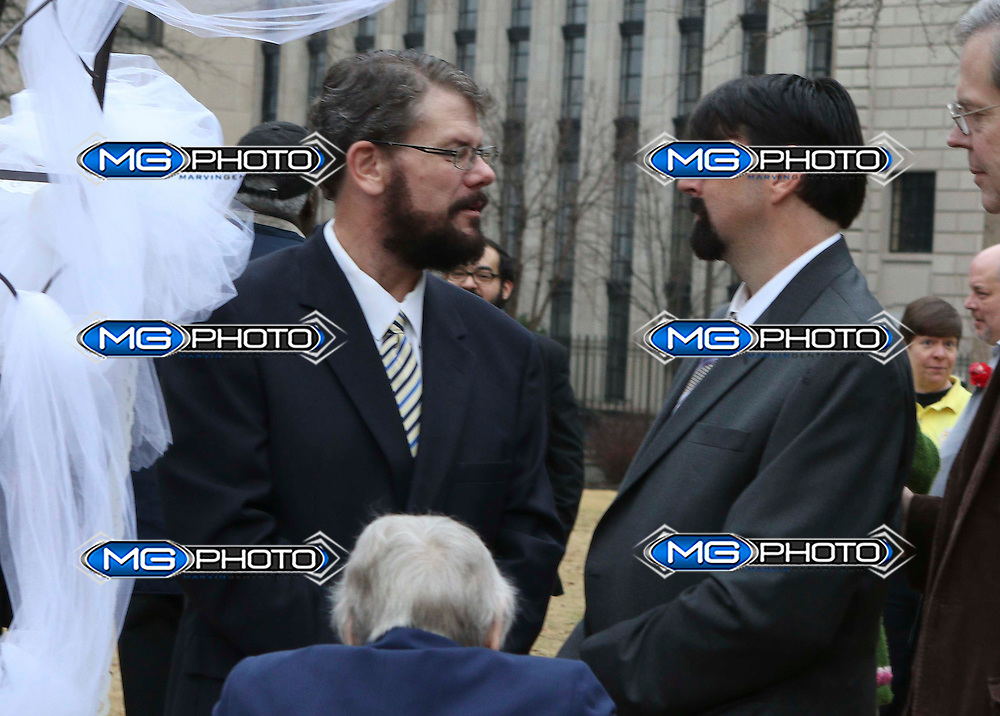 Josh and Greg Laning get married in a park outside the Jefferson County Courthouse in Birmingham, Alabama, February 9, 2015. Same-sex couples began marrying in Alabama on Monday, defying an attempt by the chief justice of the state's Supreme Court to block probate judges from issuing marriages licenses to gays and lesbians.  REUTERS/Marvin Gentry (UNITED STATES)