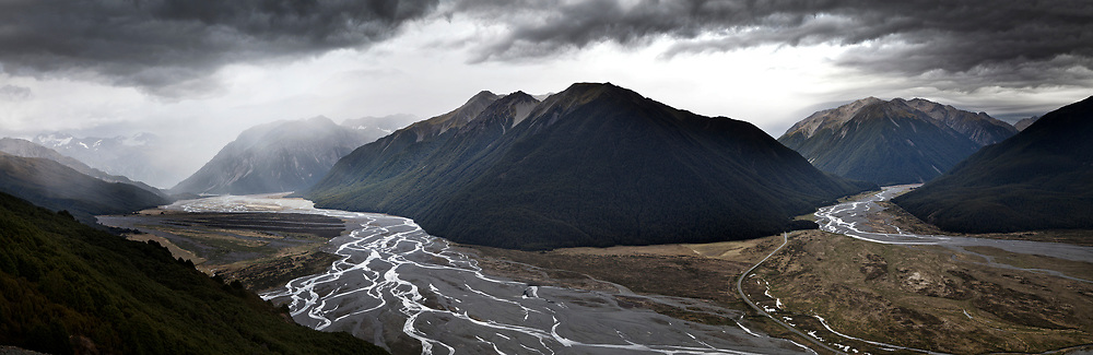 Looking up the Waimakariri and Bealey rivers into an approaching storm.