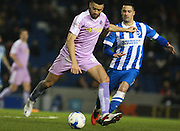 Reading defender Michael Hector passes under pressure from Brighton central midfielder Beram Kayal during the Sky Bet Championship match between Brighton and Hove Albion and Reading at the American Express Community Stadium, Brighton and Hove, England on 15 March 2016. Photo by Bennett Dean.