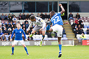 Colchester United forward Paris Cowan-Hall in a ereal tackle with Macclesfield Town defender Miles Welch-Hayes during the EFL Sky Bet League 2 match between Macclesfield Town and Colchester United at Moss Rose, Macclesfield, United Kingdom on 28 September 2019.