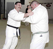 Vince Ashcraft, from Piqua (left) trains with Jim Knepp, from Piqua (right) during a judo class in the Miami County YMCA, Thursday, May 31st.