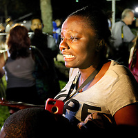Darrsie Jackson reacts to the not guilty verdict in the George Zimmerman murder trial at the Seminole County Courthouse on Saturday, July 13, 2013, in Sanford, Florida.  Zimmerman had been charged for the 2012 shooting death of Trayvon Martin and was found not guilty by a jury of six women. The protests on the grounds ended peacefully after the verdict was read. (AP Photo/Alex Menendez)