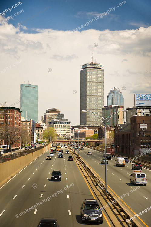 Mass Pike (I-90) on a quiet afternoon, looking back into Boston,  John Hancock tower on the left, The Prudential Tower on the right