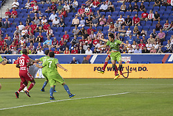 June 13, 2018 - Harrison, New Jersey, United States - Aaron Long (33) of Red Bulls & Kim Kee-hee (20) of Seattle Sounders fight for air ball during regular MLS game at Red Bull Arena Red Bulls won 2 -1  (Credit Image: © Lev Radin/Pacific Press via ZUMA Wire)