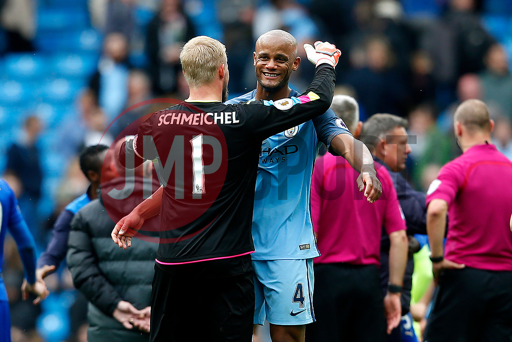 Kasper Schmeichel of Leicester City hugs Vincent Kompany of Manchester City at full time - Mandatory by-line: Matt McNulty/JMP - 13/05/2017 - FOOTBALL - Etihad Stadium - Manchester, England - Manchester City v Leicester City - Premier League