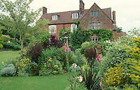 large house surrounded by well planted gardens