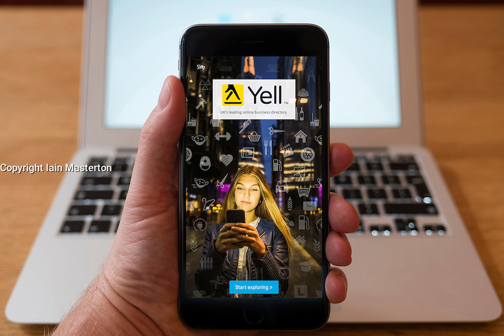 Using iPhone smartphone to display homepage of Yell the multinational directories and internet services company