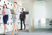 Blurred view of businesswomen walking in office