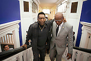 "UNITED KINGDOM, London: 22 September 2015 Legendary footballer Pele (left) walks up the stairs of the Halcyon Gallery, New Bond Street, as he launches the ""Art, Life, Football"" exhibition - in celebration of Pele's 75th birthday and a lifetime of sporting and humanitarian achievements. The exhibition opens on October 18th and includes photography, paintings and sculptures by the likes of Andy Warhol and Ronnie Wood. <br /> Credit: Story Picture Agency"