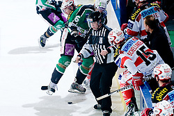 Linesman clears the way for players and puck during ice-hockey match between HDD Tilia Olimpija and EC KAC in 32nd Round of EBEL league, on December 30, 2010 at Hala Tivoli, Ljubljana, Slovenia. (Photo By Matic Klansek Velej / Sportida.com)