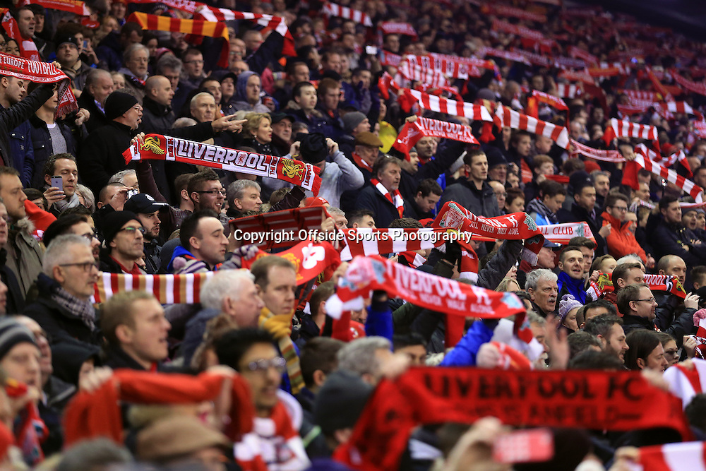 24th January 2015 - FA Cup - 4th Round - Liverpool v Bolton Wanderers - Liverpool fans hold their scarves aloft as they sing 'You'll Never Walk Alone' - Photo: Simon Stacpoole / Offside.