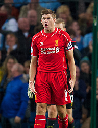 MANCHESTER, ENGLAND - Monday, August 25, 2014: Liverpool's captain Steven Gerrard looks dejected as Manchester City score the third goal during the Premier League match at the City of Manchester Stadium. (Pic by David Rawcliffe/Propaganda)