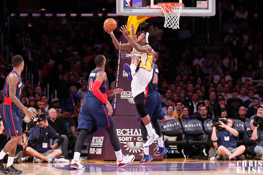 17 November 2013: Los Angeles Lakers center Jordan Hill (27) goes for the reverse acrobatic layup over Detroit Pistons power forward Greg Monroe (10) during the Los Angeles Lakers 114-99 victory over the Detroit Pistons at the Staples Center, Los Angeles, California, USA.