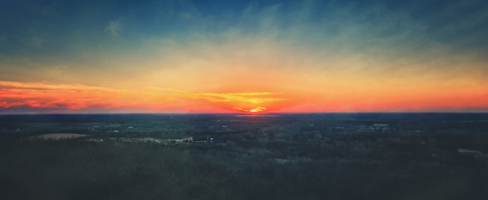 Photo taken at sunset on top of Lapham Peak's wooden observation tower.