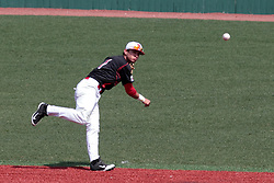 26 April 2014:   Dennis Colon hurls a fielded ball to first base during an NCAA Division 1 Missouri Valley Conference (MVC) Baseball game between the Southern Illinois Salukis and the Illinois State Redbirds in Duffy Bass Field, Normal IL