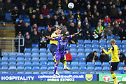 Oxford United defender defender (on loan from Columbus Crew SC) Chris Cadden (2) heads the ball under pressure from Shrewsbury Town forward Fejiri Okenabirhie (10) during the EFL Sky Bet League 1 match between Oxford United and Shrewsbury Town at the Kassam Stadium, Oxford, England on 7 December 2019.