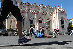 A runner takes a breather by the cathedral during the 2016 Sanlam Cape Town marathon held in Cape Town, South Africa on the 18th September  2016<br /> <br /> Photo by: Ron Gaunt / RealTime Images