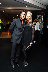 TAMARA BECKWITH and her husband GEORGE VERONI at the TAG Heuer British Formula 1 Party at the Mall Galleries, London on 15th September 2008.