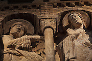 High relief of the annunciation, early 12th century, by the Master of the Tympanum, positioned 8m high on a pillar in the North transept of the Abbatiale Sainte-Foy de Conques or Abbey-church of Saint-Foy, Conques, Aveyron, Midi-Pyrenees, France, a Romanesque abbey church begun 1050 under abbot Odolric to house the remains of St Foy, a 4th century female martyr. Mary is surprised by the archangel Gabriel, on the left, whilst spinning wool, raising her hand in a gesture of acceptance. The church is on the pilgrimage route to Santiago da Compostela, and is listed as a historic monument and a UNESCO World Heritage Site. Picture by Manuel Cohen