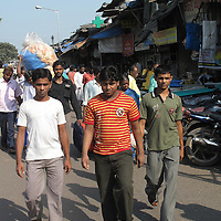 Young boys walking the streets in Dhavari, India's largest slum and one of the largest slums in the world, Mumbai, India