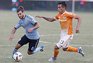 Jun 29, 2016; Houston, TX, USA; Sporting Kansas City midfielder Graham Zusi (8) dribbles against Houston Dynamo midfielder Leonel Miranda (33) in the fist half at BBVA Compass Stadium. Mandatory Credit: Thomas B. Shea-USA TODAY Sports