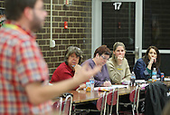 Sunny Story (from second on left), former Grant Elementary School teacher and current CREA board member, Kathy Ulrich, former Washington High School teacher and current CREA executive board member, Tania Johnson, CREA Vice President and 2013 Iowa Teacher of the Year, and Kandy Bekeris, President of Cedar Rapids Organization of Teacher Associates (CROTA), listen as CREA Secretary Pete Clancy (left) gives a report at an Association Representation Assembly by the Cedar Rapids Education Association at Kennedy High School in Cedar Rapids on Wednesday evening, November 14, 2012.