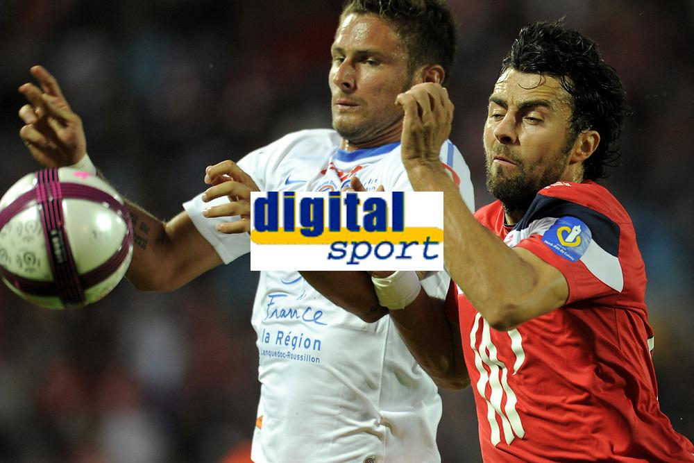 FOOTBALL - FRENCH CHAMPIONSHIP 2011/2012 - L1 - LILLE OSC v MONTPELLIER HSC - 14/08/2011 - PHOTO JEAN MARIE HERVIO / DPPI - OLIVIER GIROUD (MHSC) / MARKO BASA (LOSC)
