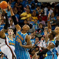 October 27, 2010; New Orleans, LA, USA;  New Orleans Hornets power forward David West (30) defends against Milwaukee Bucks small forward Corey Maggette (5) during the second half at the New Orleans Arena. The Hornets defeated the Bucks 95-91.  Mandatory Credit: Derick E. Hingle