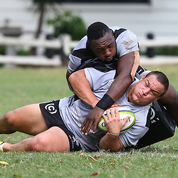 DURBAN, SOUTH AFRICA - MAY 10: Tendai Beast Mtawarira tackling Coenie Oosthuizen during the Cell C Sharks training session and press conference at Growthpoint Kings Park on May 10, 2016 in Durban, South Africa. (Photo by Steve Haag/Gallo Images)