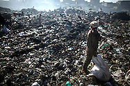 Residents sort through garbage to find recyclable items to sell at the Dandora Municipal Dumping Site in Nairobi, Kenya June 29, 2008. Scavengers search for items to sell such a metal and plastic bottles which sell for roughly half a dollar per kilogram. Daily over 2000 tons of garbage are delivered to the site which a 2007 study commissioned by the U.N. Environment Program found that half of 328 children tested round the site had lead concentrations in their blood exceeding the internationally accepted level..