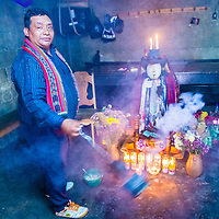 SANTIAGO DE ATITLAN , GUATEMALA - JULY 28 : Shrine of El Maximon in Santiago De Atitlan , Guatemala on July 28 2015 , Maximon saint/devil is one of the strongest remnants of the Mayan faith