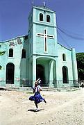 © Jean-Franc?ois Leblanc / Agence Stock Photo..E?glise protestante du village de Ti-Mouillage pre?s de Jacmel. Un dimanche pendant la messe..Protestant church of the village of Ti-Mouillage near Jacmel. Sunday during the ceremony, a young girl run...