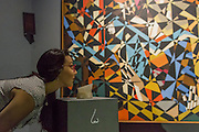 In the Hold by David Bomberg. Tate Sensorium, a new immersive art experience where visitors can taste, touch, smell and hear artworks in the collection - it is the winning project of IK Prize 2015. The Sensorium is made up of four iconic twentieth century works by: Francis Bacon – which can be tasted through chocolates created by master chocolatier Paul A. Young; David Bomberg – smelt using scented candles; Richard Hamilton – sensed through sound and smell; and John Latham – which can be experienced via the sensation of touch by inserting ones hands into the 'touchless' speakers. Tate Sensorium runs at Tate Britain from 26 August to 20 September 2015 – it is free but must be booked.