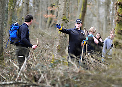 ©London News pictures. 22/03/11.  A police officer directs volunteers. Locals and friends of Sian O'Callaghan help Police in the search in Savernake Wood, Wiltshire, today. Detectives continue investigating the disappearance of office administrator Sian O'Callaghan. The 22-year-old disappeared after leaving Suju nightclub in Swindon at about 2.50am on Saturday to walk the half-mile home to the flat she shared with her boyfriend Kevin Reape. Picture Credit should read Stephen Simpson/LNP