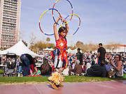 06 FEBRUARY 2011 - PHOENIX, AZ: QOOTSVENA DENIPAH-COOK, 10 years old, a Navajo Hopi Indian from the Okhay-Owingeh pueblo in New Mexico, warms up before dancing at the 21st Annual Heard Museum World Championship Hoop Dance Contest at the Heard Museum in Phoenix, AZ, Sunday, February 6. Hoop dancing has a long tradition among Native American peoples. The hoop or circle is symbolic to most Native people. It represents the Circle of Life and the continuous cycle of summer and winter, day and night, male and female. Some native people use hoop dancing as a part of healing ceremonies designed to restore balance and harmony in the world.      Photo by Jack Kurtz